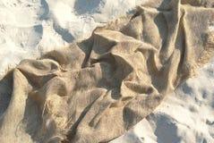 Tela di canapa sulla sabbia Fotografia Stock