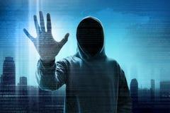 Tela digital do toque encapuçado do hacker de computador fotografia de stock royalty free