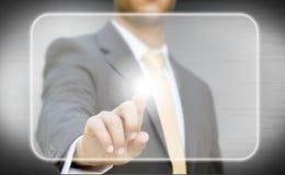Tela digital tocante do homem de negócios Fotos de Stock