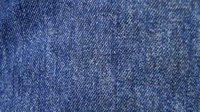 Tela do fundo da textura de calças de ganga Fotos de Stock