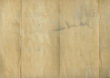 Tela doblada vieja sucia Foto de archivo libre de regalías