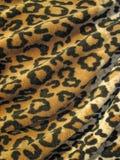 Tela drapejada marrom Fleecy da pele do leopardo Fotos de Stock Royalty Free
