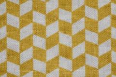 Tela escocesa amarilla en un fondo blanco Foto de archivo libre de regalías