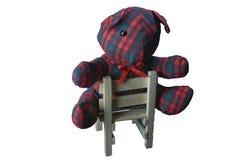 Tela escocesa Teddy Bear en una silla Imagen de archivo