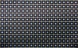 Tela escura com textura dos quadrados e das tiras Imagem de Stock