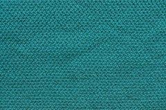 Tela feita malha textura da cor verde Fotos de Stock Royalty Free