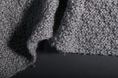 Tela gris hecha a mano aislada en un fondo oscuro Imagen de archivo libre de regalías