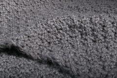 Tela gris hecha punto hecha a mano áspera Fotografía de archivo