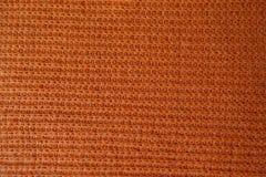 Tela hecha a mano anaranjada del punto acanalado Imagen de archivo