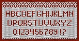 Tela hecha punto blanca con un AMOR rojo del ornamento y de la inscripción stock de ilustración