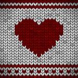 Tela hecha punto blanca con un ornamento y un corazón rojos ilustración del vector