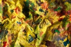 Tela manchada amarillo con la pintura foto de archivo libre de regalías