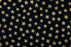 Tela preta e muitas estrelas cinco-aguçado Imagens de Stock