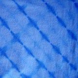 Tela tingido em nó azul Foto de Stock