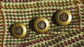 Tela y botones Imagen de archivo libre de regalías