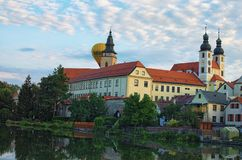 TELC, THE CZECH REPUBLIC-AUGUST 26, 2017: One hot air balloon appeared behind the tower. Sky with sunrise. royalty free stock photography