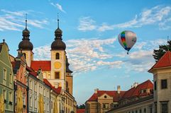 TELC, THE CZECH REPUBLIC-AUGUST 26, 2017: One hot air balloon flies over a medieval castle of Telc. royalty free stock image