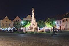 TELC, CZECH REPUBLIC: 26 AUGUST 2017 - Plague Column on the main square of Telc or Teltsch town summer evening view.  Stock Images