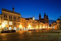 Telc, Czech republic. Historic buildings and church on the square in town Telc, Czech republic Royalty Free Stock Images