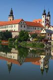 Telc is a town in southern Moravia in the Czech Republic. Telc Castle and city reflected in lake. A UNESCO World Heritage Site Stock Images