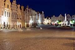 Telc - UNESCO heritage. Illuminated square in Telc, Bohemia - Czech Republic, with empty bench during dusk. UNESCO protected heritage Stock Photography