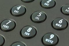 Telclado numérico con el trazado de la letra de un teléfono negro fotografía de archivo libre de regalías