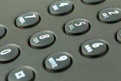 Telclado numérico con el trazado de la letra de un teléfono negro imagen de archivo