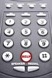 Telclado numérico de un teléfono con un botón rojo para la ayuda Fotos de archivo libres de regalías