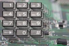 Telclado numérico del teléfono con los botones rectangulares cerca para arriba imagenes de archivo
