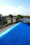 Tele incatramate sui tetti Fotografie Stock