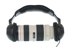 Tele lens using headphone Royalty Free Stock Photos