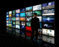 Tele Screens. Flat Panel Screens with viewer Royalty Free Stock Image