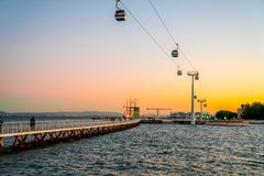The cable cars overlook the Vasco da Gama bridge on the Tagus river. Telecabine Lisboa at Parque das Nacoes Park of Nations in Lisbon, Portugal, during epic Stock Images