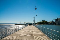 The cable cars overlook the Vasco da Gama bridge on the Tagus river. Telecabine Lisboa at Parque das Nacoes Park of Nations in Lisbon, Portugal, during epic Stock Image