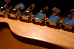 Telecaster Machines. Shot of the back of a rare telecaster head. Selective focus on the A string machine and all logos removed Royalty Free Stock Images