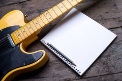 Telecaster with notepad on wood table Stock Photography