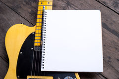 Telecaster with notepad on wood table Stock Image