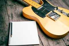 Telecaster with notepad on wood table Stock Images
