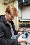 Telecom engineer looking at reflectometer Royalty Free Stock Images