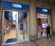 TELECOM ITALIA. BOLOGNA, ITALY - APRIL 19, 2014: A pedestrian walks past a TIM (Telecom Italia Mobile) retail shop in Bologna, Italy, on Saturday, April 19, 2014 Stock Photography