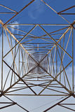 Telecom Tower. Abstract unusual view from beneath an old radio tower Royalty Free Stock Photo