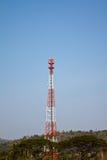 Telecom tower and blue sky. Thailand Stock Image