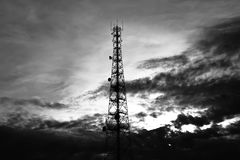 Telecom tower. On sky & clouds background - monochrome effect Royalty Free Stock Photo