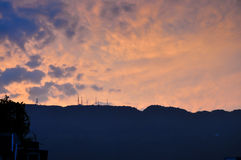 Telecom Tower in Sunset. Some telecom towers in the mountain in sunset with rosy clouds Royalty Free Stock Images