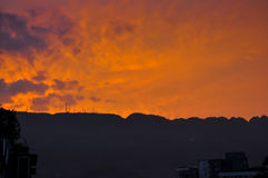 Telecom Tower in Sunset. Some telecom towers in the mountain in sunset with rosy clouds Royalty Free Stock Photo