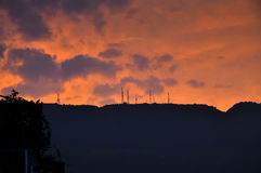 Telecom Tower in Sunset. Some telecom towers in the mountain in sunset with rosy clouds Stock Image