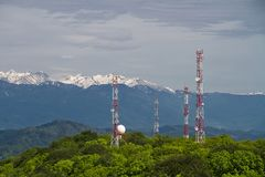 Telecom towers in mountains. Telecom towers in ambience of high snowy mountains royalty free stock image