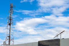 Telecom towers with satellites. Stock Images