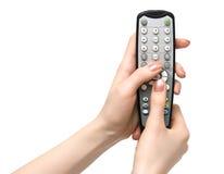 Telecomando della holding TV Fotografia Stock