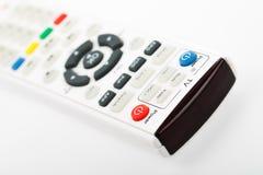 Telecomando della TV isolato su priorità bassa bianca Fotografie Stock